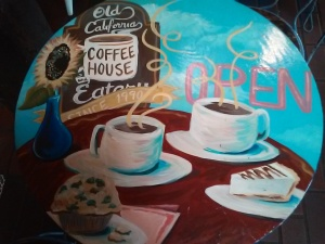 Their table tops are adorned with coffee scenes like this one.